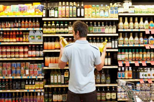 man-reading-food-label