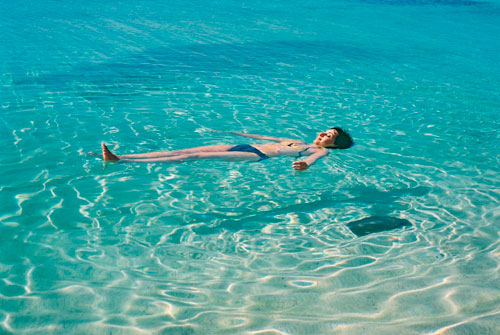 Cuba-Trinidad-Caribbean-Sea-Playa-Ancon-woman-floating-on-clear-water-shadow-1-MY