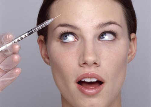 Young Woman Having Botox Injection --- Image by © Michael A. Keller/zefa/Corbis