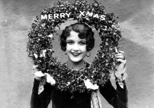 Christmas-1927-wreath-around-face-of-woman