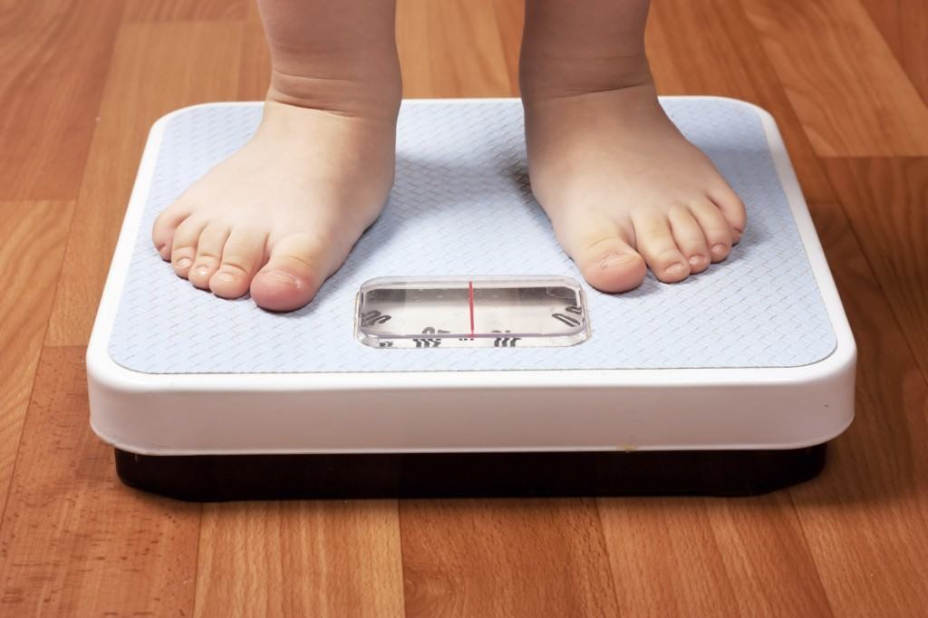 Closeup view of scales on a floor and kids feet