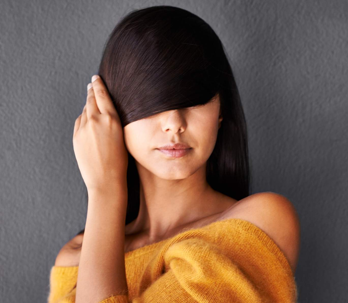 Closeup shot of an attractive young woman covering her eyes with her hairhttp://195.154.178.81/DATA/i_collage/pi/shoots/783562.jpg