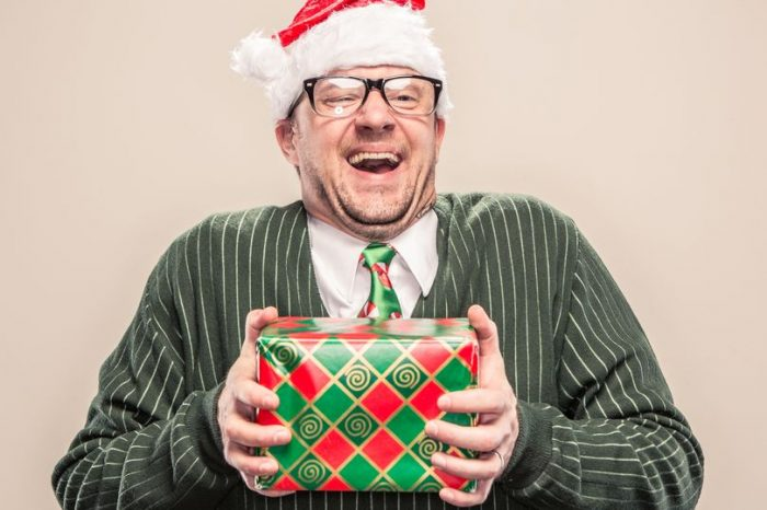 PROD Nerdy Geek Christmas Man Holding Wrapped Holiday Gift