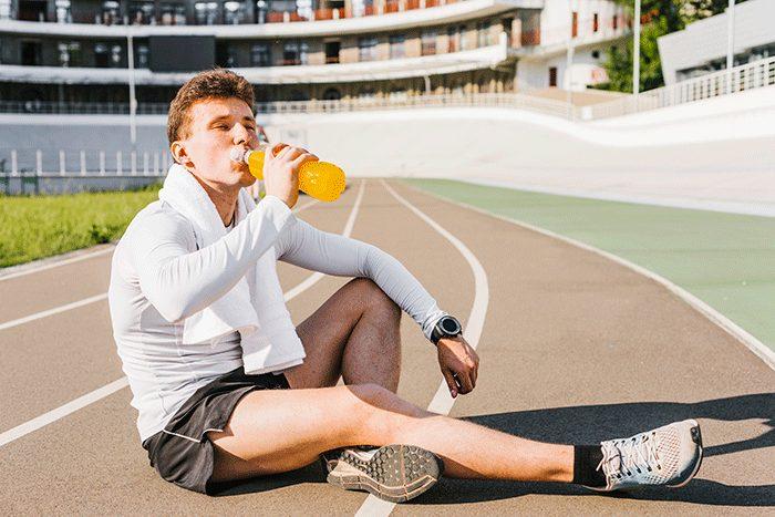 Deportista Bebiendo