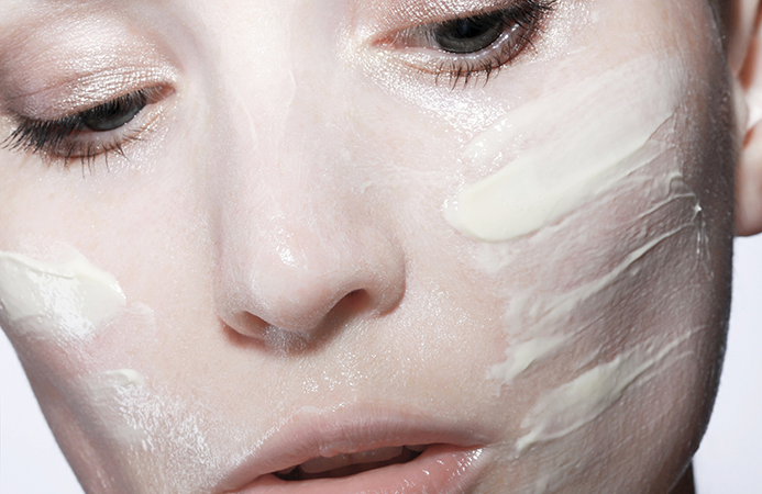 Close Up Photo Of Woman With Face Cream 3686824