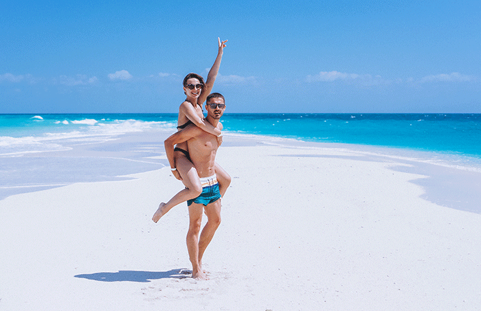 Couple Happy Together On Vacation By The Ocean